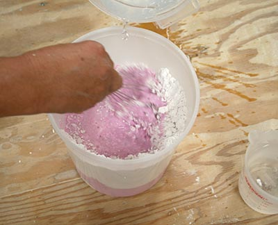 Mixing our 380-CC alginate is interesting because it turns bright pink when the water hits it. It will slowly fade to white about 40 seconds before it sets.